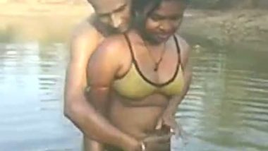 Village couple outdoor bath in pond