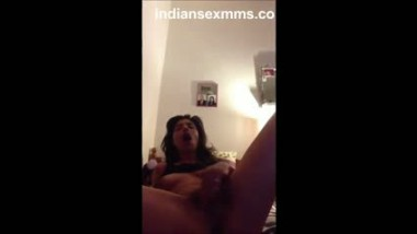 Spreading legs fingering pussy wildly