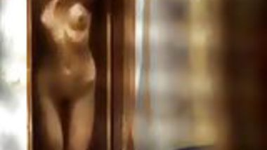 Desi Neighbour bachi Undressing for Bath Caught Topless