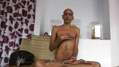 Beautiful holy naked Indian man teaching meditation