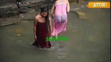 Indian village girls having a public bath